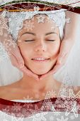 Portrait of a smiling woman having a facial massage in a christmas frame