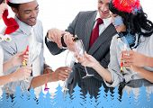 Business team drinking champagne to celebrate christmas against snowflakes and fir trees in blue