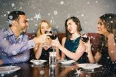 Composite image of Friends clinking red wine glasses at a bar against snow