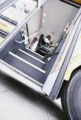 stock photo of bus driver  - Low angle view of driver in school bus - JPG