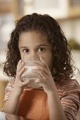 Portrait of girl drinking milk
