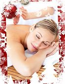 Attractive woman receiving a tapping massage against christmas themed frame