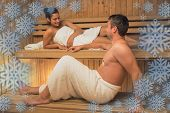 Calm couple relaxing in a sauna and chatting against snowflake frame