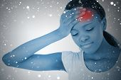 Composite image of woman with highlighted headache against snow