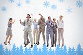 Very happy business people jumping and clenching their fists against snowflakes and fir trees in blue