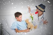 Doctor in clown costume entertaining ill boy in hospital against snow