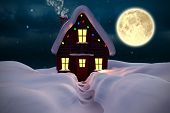 Composite image of christmas house against stars twinkling in night sky