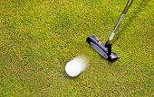 Golf: putter club with white golf ball