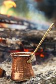 Making coffee in the fireplace  on camping or hiking in the nature