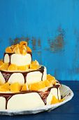 Beautiful wedding cake with oranges and chocolate on wooden background