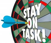 Stay on Task 3d words on a dart board to illustrate being diligent and completing a job, project or work