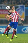 VIENNA, AUSTRIA - OCTOBER 22 Emir Dilaver (#27 Austria) and Raul Garcia (#8 Atletico) fight for the ball at a UEFA Champions League game on October 22, 2013 in Vienna, Austria.