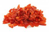 cut pieces of red sweet pepper(capsicum) on a white background