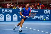 SEPTEMBER 23, 2014 - KUALA LUMPUR, MALAYSIA: Pierre-Hugues Herbert of France watches the ball fly out in his first round match at the Malaysian Open Tennis 2014. This is an ATP sanctioned tournament.