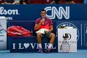 SEPTEMBER 23, 2014 - KUALA LUMPUR, MALAYSIA: Bernard Tomic of Australia takes a drink at game break in his match at the Malaysian Open Tennis 2014 event. This is an ATP sanctioned tournament.