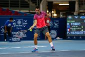 SEPTEMBER 23, 2014 - KUALA LUMPUR, MALAYSIA: Bernard Tomic of Australia makes a forehand return in his first round match at the Malaysian Open Tennis 2014 event. This is an ATP sanctioned tournament.