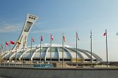 MONTREAL  CANADA - SEPT 05: Olympic stadium with international flags on september 05, 2014 in MONTREAL