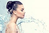 pic of beauty  - Beautiful Model Woman with splashes of water in her hands - JPG