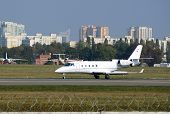 KIEV, UKRAINE - September 27, 2014: Small jet taking off in Kiev International Airport