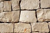 Ancient wall of stone blocks