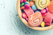 top view of colorful candy on old table