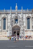 Lisbon, Portugal. August 24, 2014: The Jeronimos monastery with a view over the heavily ornated south portal. Classified as UNESCO World Heritage it stands as a masterpiece of the Manueline art.