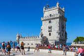 Lisbon, Portugal. August 24, 2014: Belem Tower, a famous masterpiece of the Manueline Architecture, a Portuguese Gothic style. Portuguese landmark classified as World Heritage Site by Unesco.