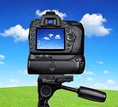 Dslr camera photographing blue sky
