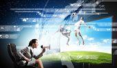 Emotional woman watching football match on 3 d tv