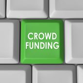 Crowd Funding words on a 3d green computer keyboard key or button to illustrate financial support, help or assistance from a broad audience of customers, viewers and investors