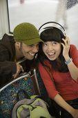 Couple listening to headphones