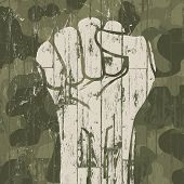 Fist symbol (revolution) on military camouflage background. Vector.