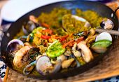 Close up of a delicious seafood paella in a pan