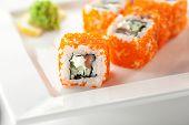 Maki Sushi with Fresh Salmon, Cucumber and Cream Cheese inside. Tobiko outside