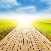 Image of stone pathway and sunlight in the park.