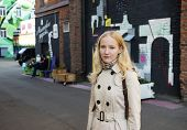 Young blond girl standing on the street