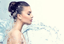 foto of wet  - Beautiful Model Woman with splashes of water in her hands - JPG
