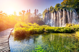 image of nationalism  - Majestic view on waterfall with turquoise water and sunny beams in Plitvice Lakes National Park - JPG