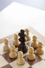 foto of pep talk  - Chess game black king surrounded by white pawns - JPG