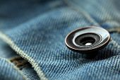 Metal button on clothes close up