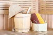 Traditional Wooden Sauna For Relaxation With Bucket Of Water And Set Of Clean Towels