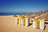Piles of deck chairs in a beach in Estoril, Portugal