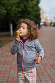 Little girl with icecream in the park