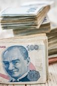 picture of turkish lira  - Bunch of Turkish Lira over white wooden background - JPG