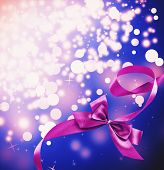 Satin ribbon bow on bright background
