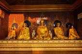 Buddha statues in Burma famous sacred place and tourist attraction landmark - Shwedagon Paya pagoda. Yangon, Myanmar