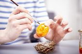 Young Girl Paint Eggs For Easter
