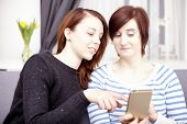 Two Young Girls With Smart Phone