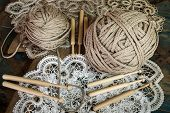 lace with a ball of yarn