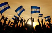 Silhouettes People Holding Flag Honduras Concept